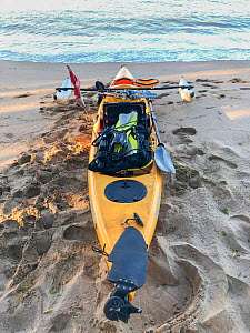 Photographer David Fleetham's kayak used for diving and photography off Maui's beaches. The inflatable outriggers make it very stable for getting into and out of. Dive gear and tank are strapp...  -  David Fleetham