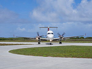 Beechcraft 1900 aircraft arriving to pick up passengers on Astove Atoll, Seychelles, November 2019.  -  David Tipling