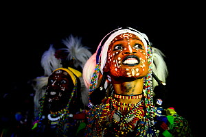 Two men from Wodaabe ethnic group dancing and singing with painted faces during Gerewol celebration, a gathering of different clans in which women choose a husband. Chad, Sahel, Africa. 2019.  -  Enrique Lopez-Tapia