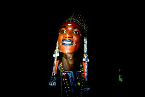 Man from Wodaabe ethnic group,head portrait at night. During Gerewol gathering of different clans women choose a husband. Men dress in best clothes and ornaments and sing and parade in front of the yo...  -  Enrique Lopez-Tapia