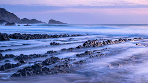 Welcombe Mouth at high tide, evening light, taken with exposure, Welcombe, North Devon, UK. April.  -  Ross Hoddinott