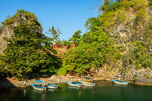 Boats moored in river canyon near Yumury, Cuba. March 2019.  -  Bruno D'Amicis