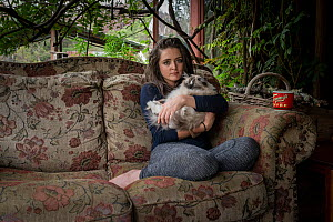 Emily Small,one of the founders of the Goongerah Wombat Orphanage, sits on the veranda of her house, with her ragdoll cat �Cotton', shortly after the 2019/20 bushfires devastated the area. Emily's...  -  Doug Gimesy