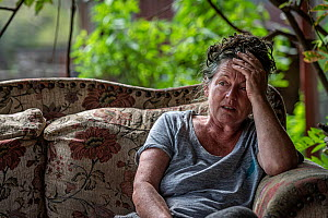 Sharon Small, one of the founders of Goongerah Wombat Orphanage, sitting at home after the 2019/20 bushfires devastated the area. Sharon's house was spared, but she lamented the loss of her surrou...  -  Doug Gimesy