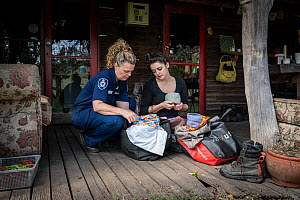Forest and wildlife Officer from the Department of Land, Water and Planning (DEWLP) Abby Smith visits and drops off some supplies to the founder of Goongerah Wombat Orphanage, Emily Small, soon after...  -  Doug Gimesy