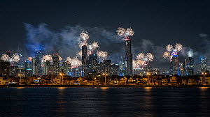 Fireworks over Melbourne city skyline for New Year celebrations. View from Port Philip Bay, St Kilda, Victoria, Australia. January 2018.  -  Doug Gimesy