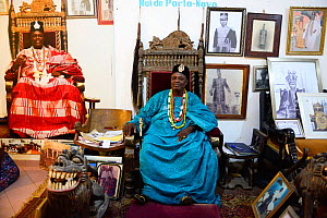 King of Porto Novo, Toffa IX sitting on throne chair in the palace courtroom, surrounded by photographs, Benin, 2020.  -  Enrique Lopez-Tapia