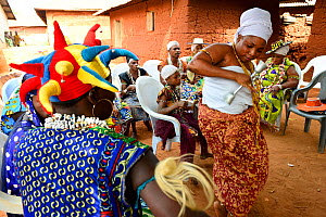 Women dancing in vodoo ceremony, group of people sitting in background. In a small village near Abomey, Benin, 2020.  -  Enrique Lopez-Tapia