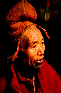 Portrait of Lama / monk in Lingshed Gompa, a Buddhist monastery founded by the Gelupka order. At an altitude of 3850m. Zanskar, Ladakh, India. 2011.  -  Enrique Lopez-Tapia