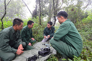 Fauna & Flora International staff and GMT (Gibbon Monitoring Team) engaged in AudioMoth (acoustic recorder) training. Cao vit gibbon Species & Habitat Conservation Area, Trung Khanh district, Cao Bang...  -  Hoang Van Tuan / Fauna & Flora International