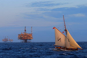 Sailing vessel ' Mascotti' with Forties Oil Rigs in the distance, North Sea, August 2019.  -  Philip  Stephen