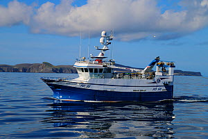 Fishing vessel 'Harvest' with Fair Isle in the distance. Property Released.  -  Philip  Stephen