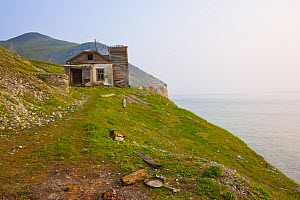Abandoned buildings at Cape Dezhnev in the Bering Strait, Chukotka, Russia.  -  Jenny E. Ross