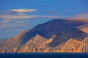 Dramatic cliffs rise from the Bering Strait at Cape Dezhnev, Chukotka, Russia.  -  Jenny E. Ross