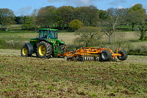 John Deere tractor with a Simba power disc harrow cultivating set-a-side field before planting with maize in Devon, April  -  Nigel Cattlin