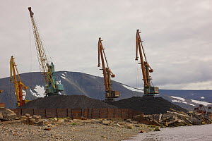 Large piles of coal and coal ash lie on the ground at the Port of Provideniya, very close to the water's edge, at the shore of Komsoloskaya Bay , Bering Sea, Russia.  -  Jenny E. Ross