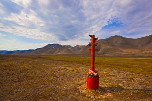 Marker designating the location where the Arctic Circle intersects the 180th meridian in the Siberian tundra of the Chukotka Autonomous Okrug. Chukotka, Siberia, Russia.  -  Jenny E. Ross