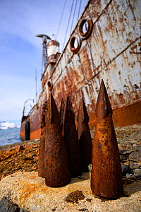 Whaling harpoon tips lie next to the ship Petrel that was used for whale hunting in Antarctic waters. It now stands grounded at Grytviken, South Georgia Island, Antarctica.  -  Jeff Vanuga