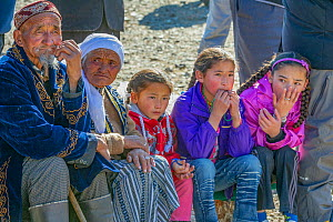 Kazakh family, local spectators at the Eagle Hunters festival near Ulgii, Western Mongolia October 2011.  -  Jeff Foott