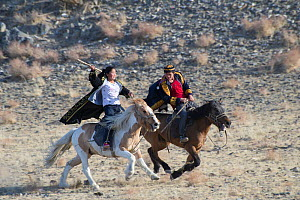 Male-female horse race, at the Eagle Hunters festival near Ulgii, Western Mongolia.  -  Jeff Foott