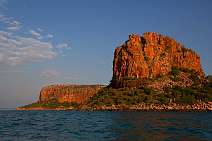 Raft Point iron rich sandstone formation glowing in sunset light, Kimberley coast, Western Australia  -  Fred Olivier