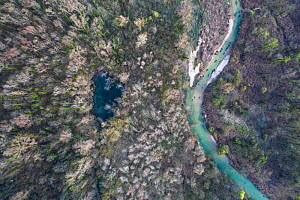 Aerial view of a Karst spring and river, Marais de Lavours Reserve, Ain, Alps, France, November.  -  Remi Masson