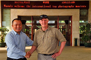 Photographer Staffan Widstrand with the hotel director at Hot spring resort in Xu Wen, Guangdong province, China  -  Staffan Widstrand / Wild Wonders of China