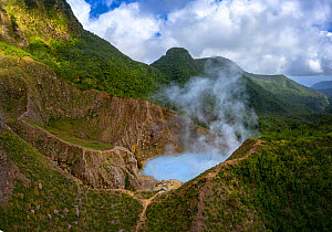 Steam and gases rising from Boiling Lake, a water filled fumarole on active volcano, surrounded by cloud forest. Morne Trois Pitons National Park, Dominica, Lesser Antilles. 2020.  -  Derek Galon