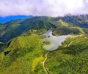 Aerial view of Freshwater Lake amongst cloud forest, in mountains at approximately 2500 feet, largest lake on island. Dominica, Lesser Antilles. 2020.  -  Derek Galon