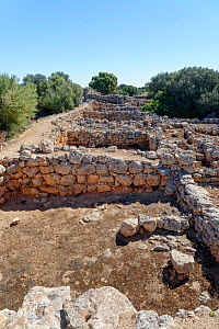 Ruins of ancient stone houses at Capocorb Vell, a much excavated settlement built by the Talaiotic culture, which flourished in Mallorca between around 1300 and 800 BC, near Cala Pi, Mallorca. May 201...  -  Nick Upton