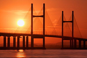 Second Severn Crossing suspension bridge over River Severn between England and Wales, at sunset. Gloucestershire, England, UK. September 2006.  -  Guy Edwardes
