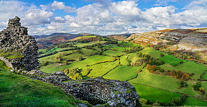 View looking looking north west from the ruined walls of Castell Dinas Bran with the Eglwyseg escarpment on the right and Llantysilio Mountain in the background North Wales, UK. October 2019.  -  Alan Williams
