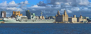 HMS Prince of Wales aircraft carrier moored at the Liverpool Pierhead on the River Mersey with the Three Graces building on the right, Liverpool, England, UK, March 2020.  -  Alan Williams