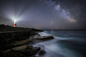 Portland Bill lighthouse at night with Milky Way, Isle of Portland, Jurassic Coast World Heritage Site, Dorset, England, UK, June.  -  Guy Edwardes