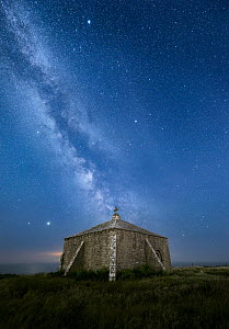 St Aldhelm's Chapel at night with the Milky Way, St Aldhelm's Head, Isle of Purbeck, Dorset, England, UK, June 2020.  -  Guy Edwardes