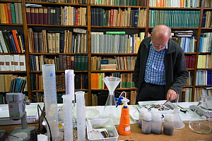 Entomologist with sample of Insects caught in malaise trap, reference books in background. Long-term monitoring has revealed a 75% decline in insect biomass over 27 years. Entomological Society Krefel...  -  Edwin Giesbers