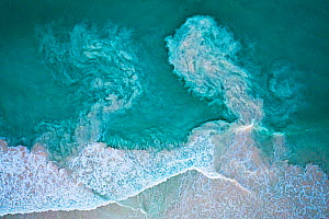 Waves crashing on beach and carrying sediments back out to sea, aerial view. The Bahamas.  -  Shane Gross