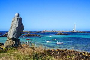 Statue of Victor Hugo and the 'Phare de l'île Vierge', tallest stone lighthouse in Europe, Lilia, Plouguerneau, Finistere, Brittany. September 2019  -  Philippe Clement