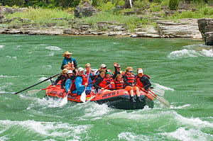 Paddle raft of people approaching Lunch Counter Rapids, Snake River, Jackson Hole, Wyoming, USA. July 2006.  -  Jeff Foott