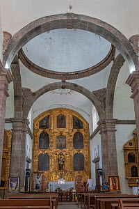 Altar with reredos on wall, pews in foreground. Mission San Francisco Javier. Near Loreto, Baja California Sur, Mexico. 2020.  -  Jeff Foott