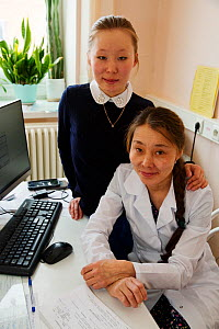 Anastasia Puyko,a Nenets woman, who works as a nurse at the hospital in Yar-Sale. Her daughter, Elvira (behind) is studying banking. Yar-Sale, Yamal, NW Siberia, Russia. 2018.  -  Bryan and Cherry Alexander