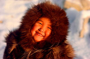 An Inuit girl, Sofie, warmly dressed in a fox fur hooded jacket (kapataq). N.W. Greenland. 1987  -  Bryan and Cherry Alexander