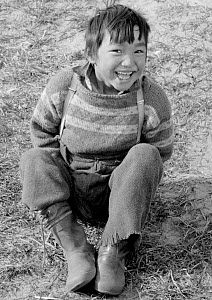 Thomas Qujaukitsok, an Inuit boy, laughing at Inerssussat. Thule, Northwest Greenland. 1971  -  Bryan and Cherry Alexander