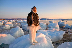Sofie Jensen, a young Inuit woman, dressed in traditional sealskin clothing. Qaanaaq, Northwest Greenland. 2008.  -  Bryan and Cherry Alexander