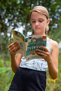 Local student reading Sloth conservation booklet during Sloth Conservation Foundation community education session. Puerto Viejo de Talamanca, Costa Rica. 2010.  -  Suzi Eszterhas