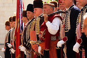 Men in traditional dress standing in row at Alka commemorations. Held on the first Sunday in August since 1715 the Alka commemorates the victory of Christians over Ottoman Turks. Inscribed on UNESCO I...  -  Kristel Richard