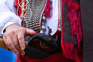 Man in traditional dress holding gun during Alka commemorations, close up. Held on the first Sunday in August since 1715 the Alka commemorates the victory of Christians over Ottoman Turks. Inscribed o...  -  Kristel Richard