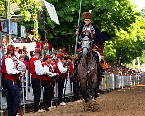 Man on horseback in traditional dress participating in Alka commemorations, crowd spectating in background. Held on the first Sunday in August since 1715 the Alka commemorates the victory of Christian...  -  Kristel Richard