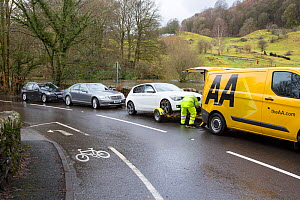 Breakdown vehicle picking up cars broken down in floodwaters of Storm Ciara. Rothay Bridge, Ambleside, Lake District, England, UK. February 2020.  -  Ashley Cooper