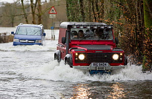 Land Rover driving through flood caused by Storm Ciara. Rothay Bridge, Ambleside, Lake District, UK. February 2020.  -  Ashley Cooper